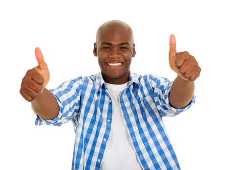 thumbs up sign: portrait of young african man giving thumbs up on white background