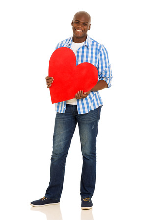 happy young african American man holding heart shape over white background photo