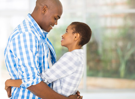 lovely couple: portrait of loving african couple hugging