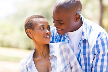 lovely couple: romantic young african couple embracing while looking at each other Stock Photo