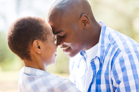 african american couple: intimate african american couple flirting outdoors
