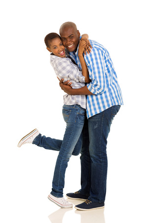 cheerful african american couple hugging on white background photo