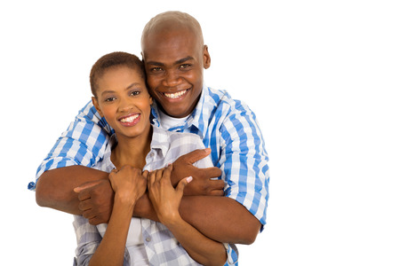 husbands and wives: close up portrait of happy young african american married couple