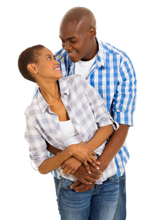 young afro american couple embracing over white background photo