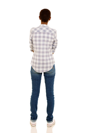 woman standing back: rear view of african american woman isolated over white background Stock Photo