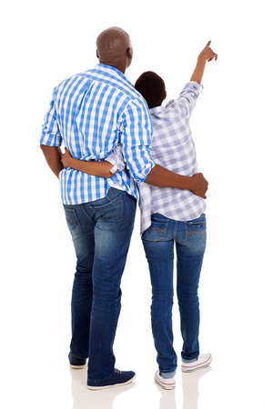 back view of young african american couple pointing isolated on white photo