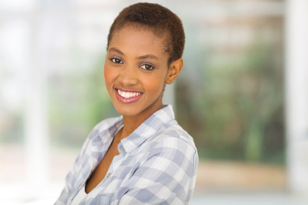 girl short hair: close up portrait of young african american woman at home