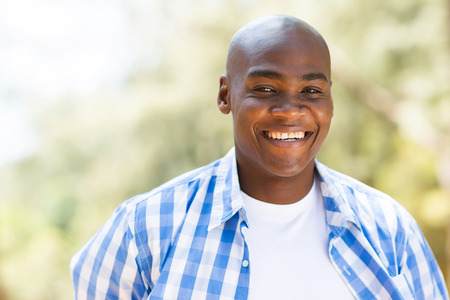 smile close up: close up portrait of young african american man outdoors