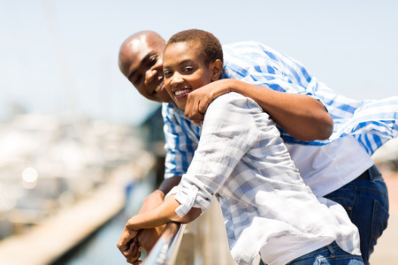 happy african american couple enjoying their vacation by the harbor photo