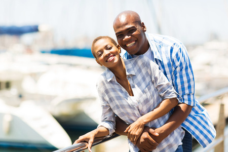 portrait of cheerful african couple at the harbor photo