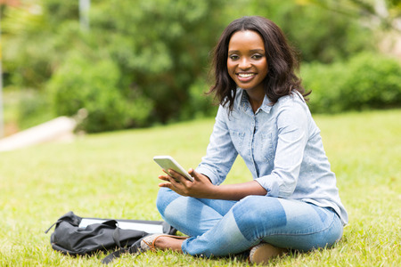 tertiary: portrait of african college girl sitting at the park
