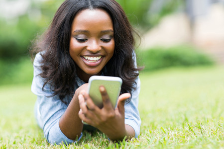 cheerful african american woman using smart phone
