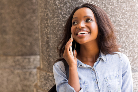 lady on phone: happy african college girl talking on mobile phone