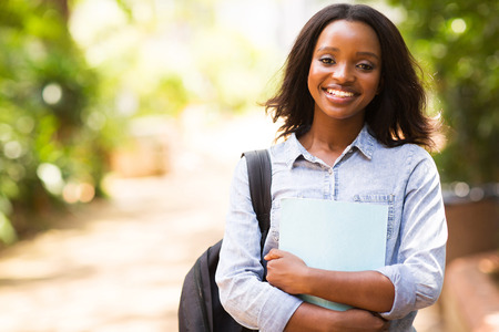 attractive female: portrait of african college student holding a book