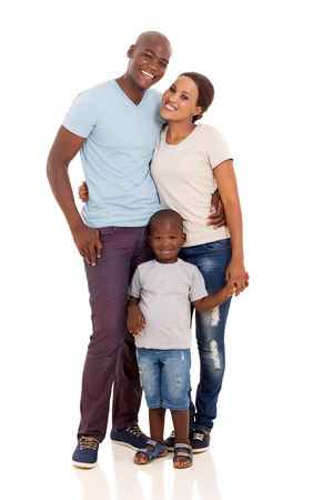 cute young african couple standing with their son isolated on white