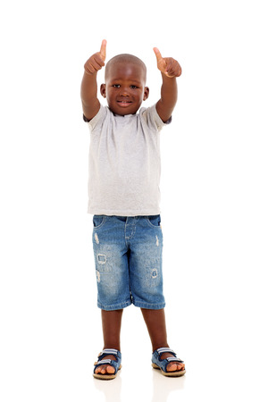 posing  agree: adorable african boy showing two thumbs up on white background Stock Photo