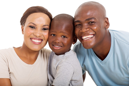 holding family together: young loving african american family isolated on white Stock Photo