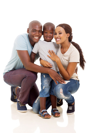 beautiful african american couple and son isolated on white