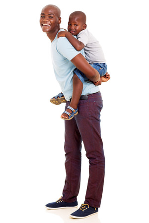 piggy back: lovely african father giving his son piggyback ride on white background