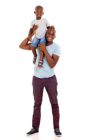 shoulder carrying: cheerful young african american man carrying son on his shoulder