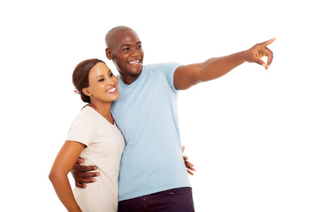 happy couple white background: happy african couple pointing on white background