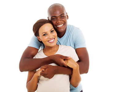 happy couple white background: lovely young black couple looking at the camera on white background Stock Photo