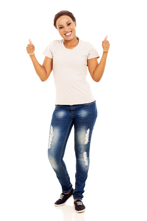 thumbs up woman: happy young african woman showing thumbs up on white background