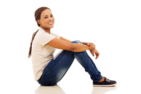 happy african woman: happy young african woman sitting on floor Stock Photo