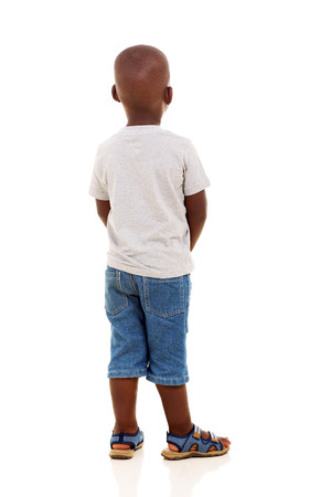 white back: rear view of young african boy isolated on white background