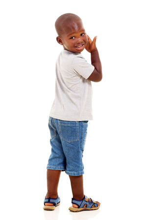 boy jeans: cute little african american boy looking back isolated over white background Stock Photo