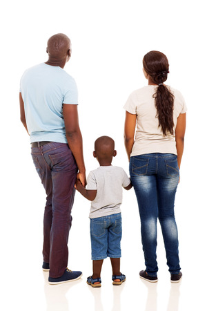 back view of young african family holding hands isolated on white Standard-Bild