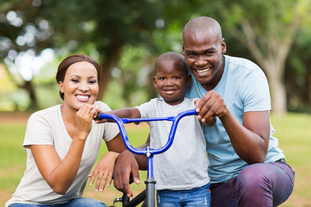 adorable afro american family having fun together outdoors Banque d'images