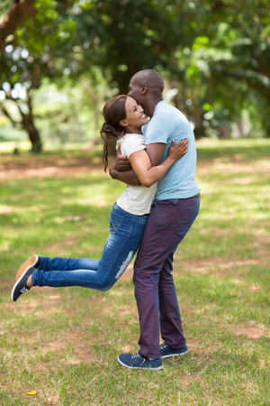 couple having fun: playful young african couple having fun in the park Stock Photo