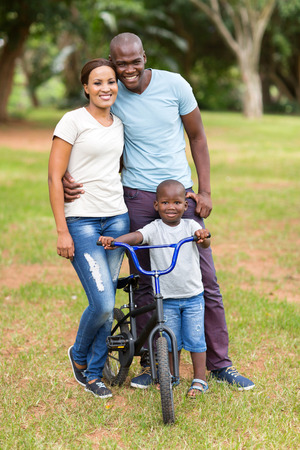 cute young african american family portrait outdoors