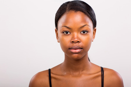 cute african american girl without makeup on plain