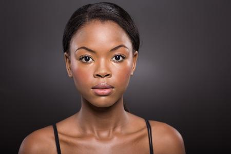 bra model: portrait of african female beauty on black