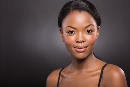 portrait of pretty african american woman on black