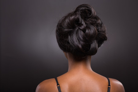 woman back view: rear view of african female stylish hairstyle