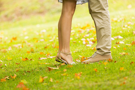 romantic kiss: couple kissing outdoors at the park Stock Photo
