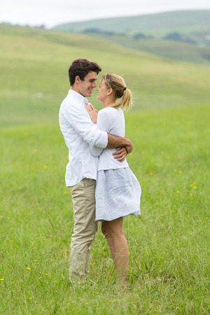 country boy: lovely couple flirting on countryside Stock Photo