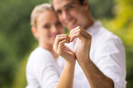 lovely young couple making heart with hands Stock Photo