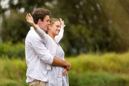 adorable young couple having fun outdoors photo