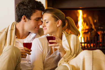 romantic evening with wine: loving young couple enjoying spend time together at home