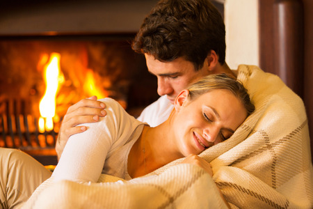 beautiful couple relaxing at home on a cold winter day Stock Photo
