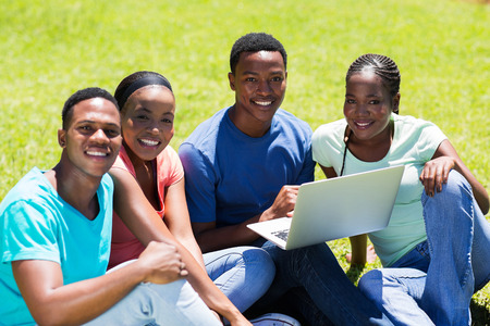 african american: group of african american college friends sitting together at the park Stock Photo