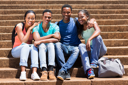 group of beautiful african university students sitting on steps photo