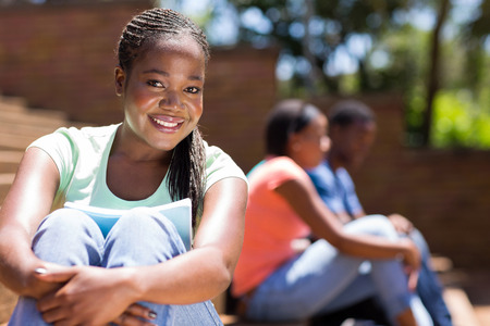 tertiary: gorgeous afro american college girl sitting outdoors Stock Photo