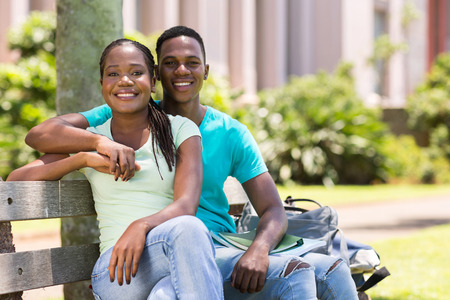 lovely african american university couple sitting outdoors photo
