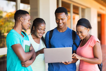 group of modern african university students using laptop Stock Photo