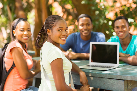 group of african college student relaxing outdoors and looking at the camera photo